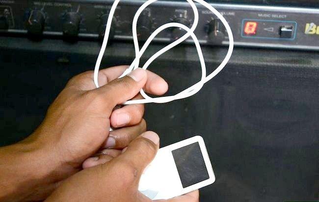Imagine intitulată Redarea unui iPod Shuffle prin boxele stereo Pasul 1