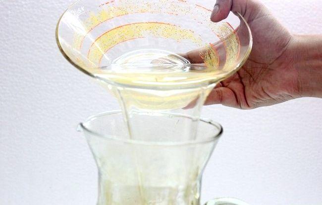 Imaginea intitulă Faceți limonada de lime și ghimbir Pasul 9