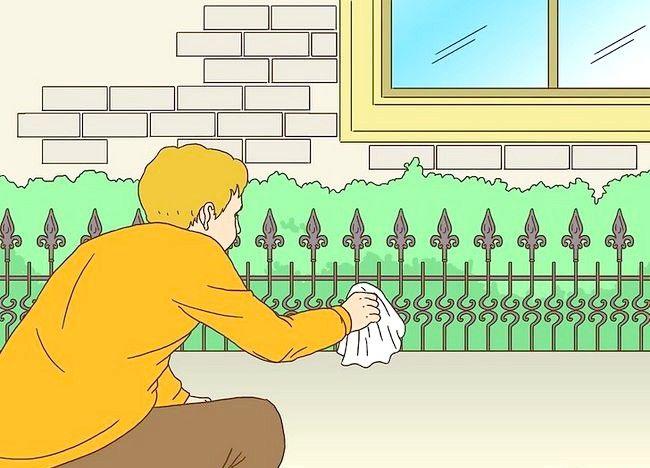 Imagine cu titlul Pregătiți un gard din fier forjat pentru pictura Pasul 3